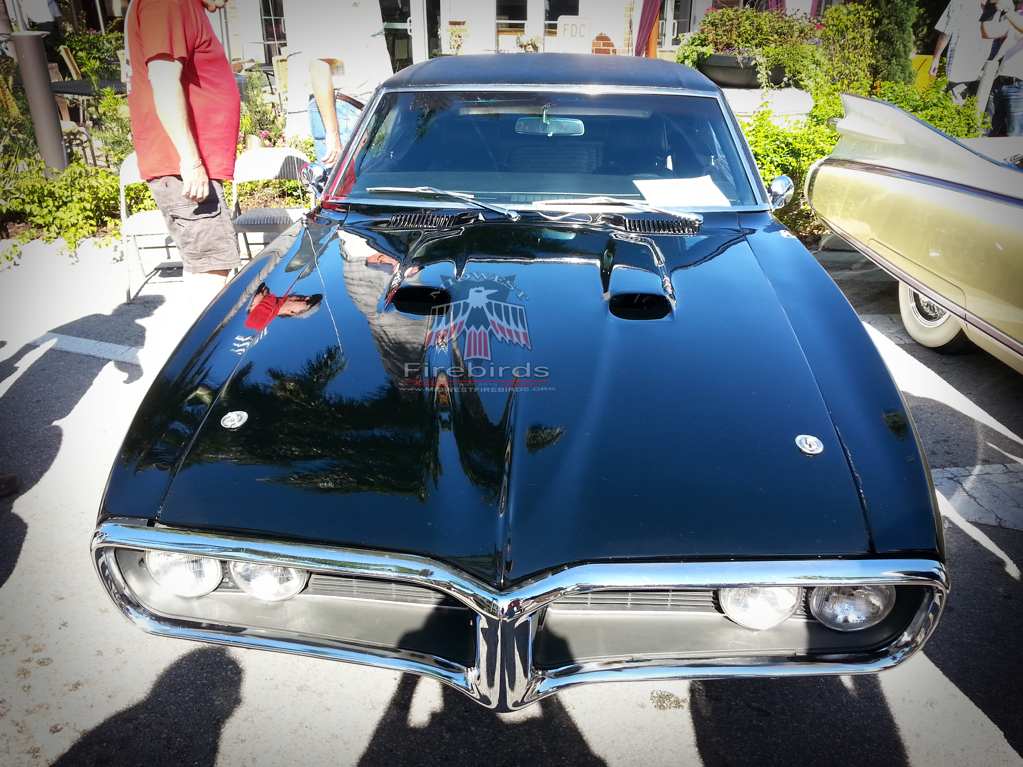 First-generation Pontiac Firebirds on display at the Cars on 5th car show in Naples, Florida.