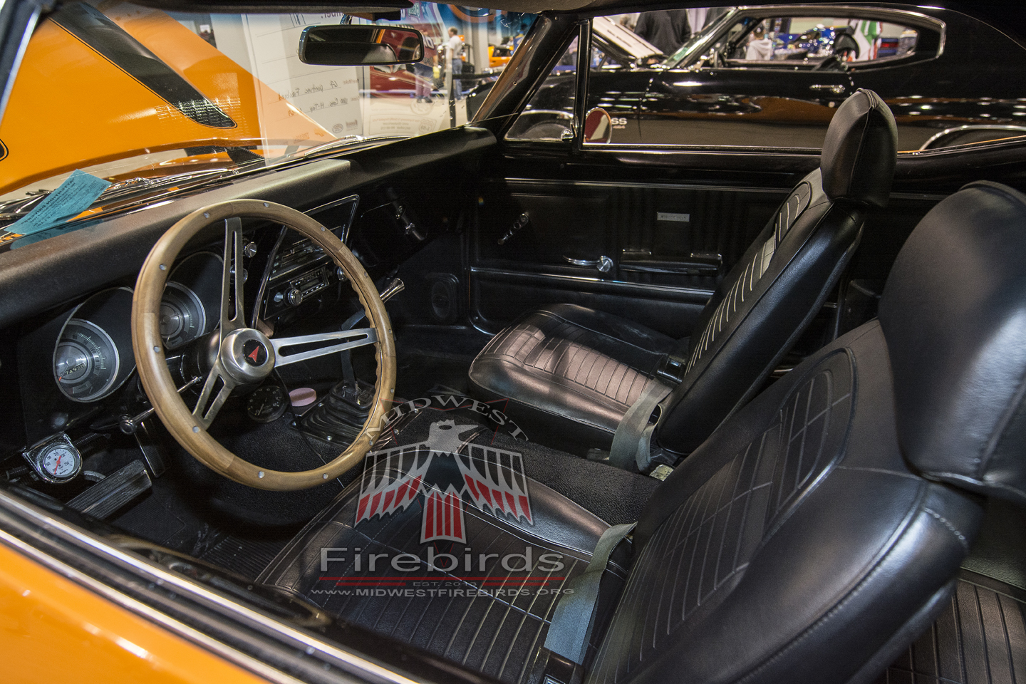 This orange 1967 Pontiac Firebird coupe was on display at the 2014 World of Wheels car show.